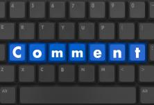 keyboard with the word Comment written in