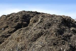 pile of compost against a blue sky