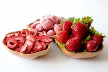 three bowls with strawberries, fresh, frozen, and dehydrated