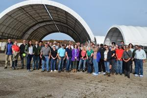 group touring the composting facility