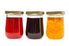three glass jars of jelly