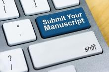 """computer keyboard with the phrase """"submit your manuscript"""""""